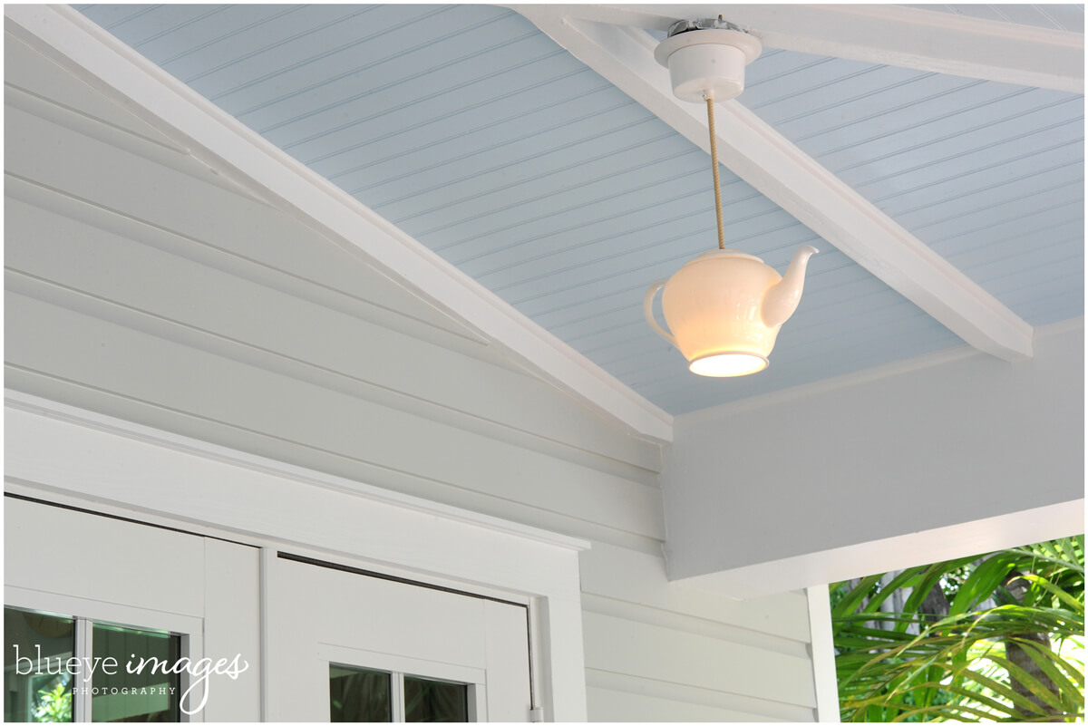 renovated exterior home with kettle ceiling light