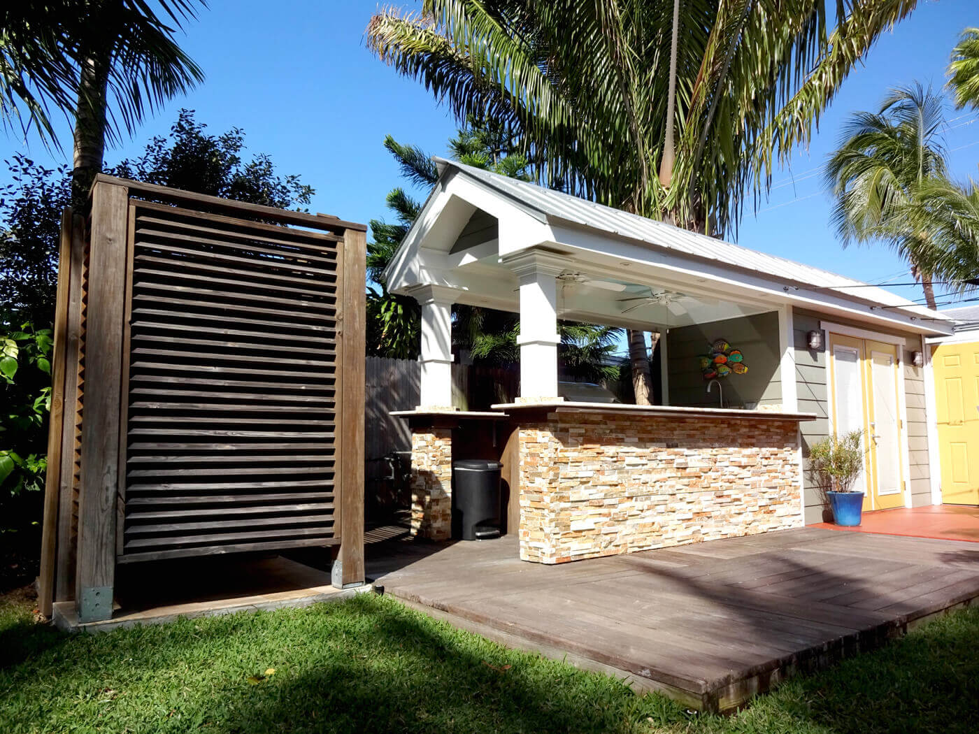 full view of outdoor kitchen and shower in Key West