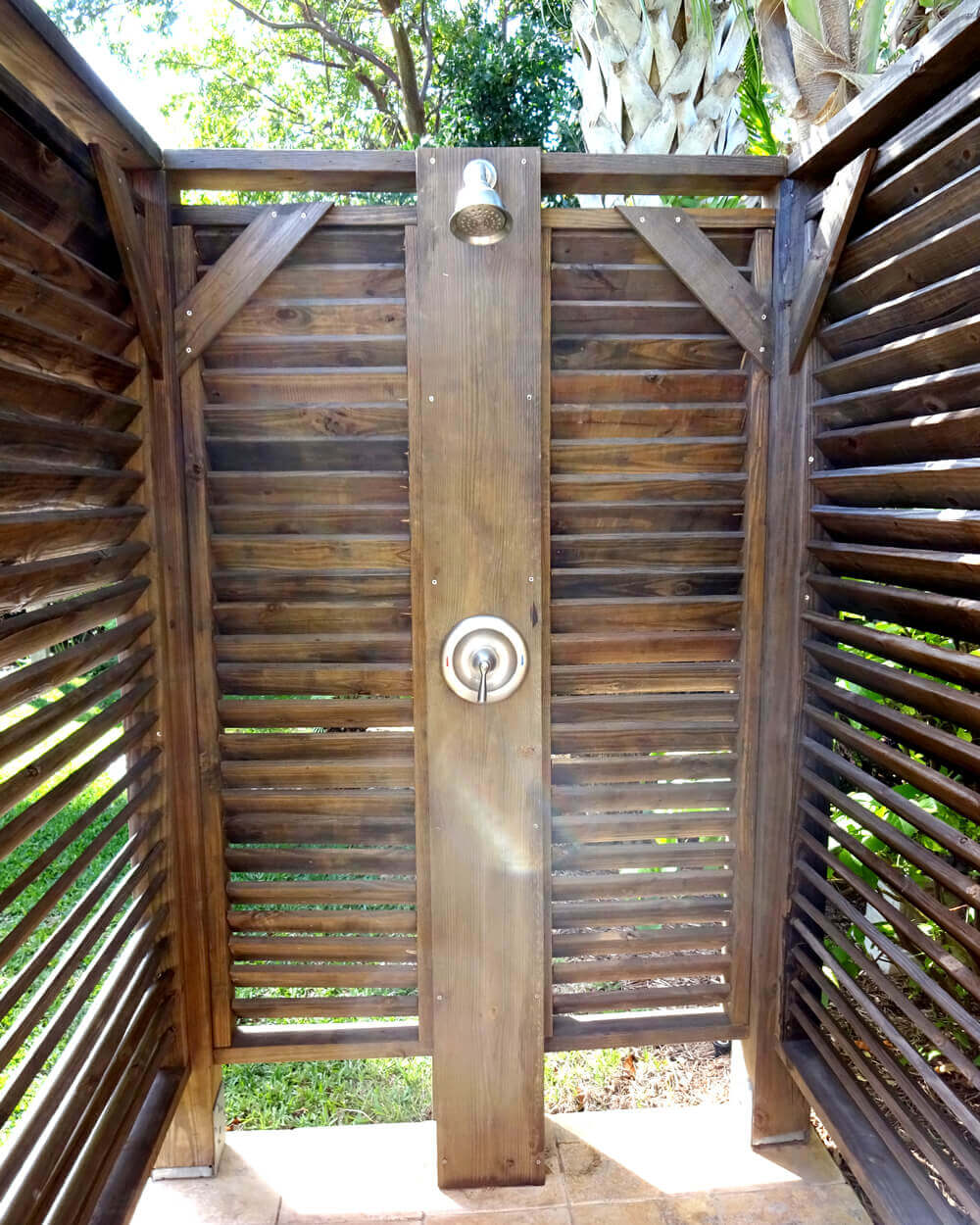 inside of an outdoor shower with tile floor