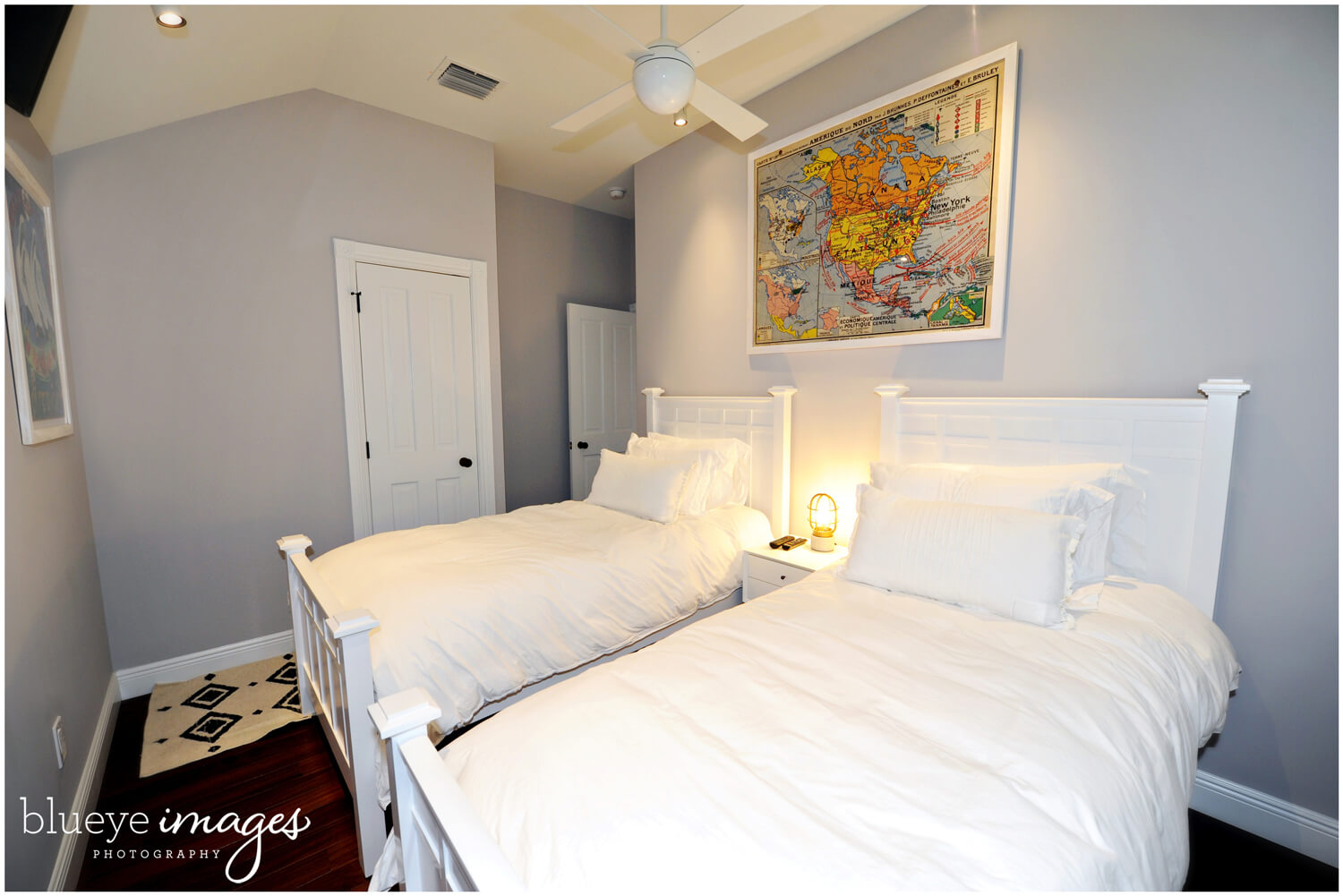 renovated bedroom with two twin beds